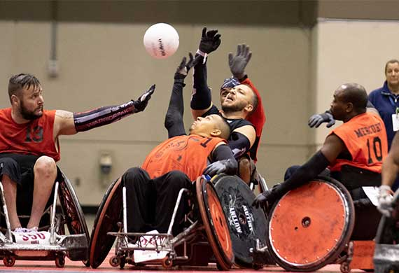 People playing Quad Rugby.